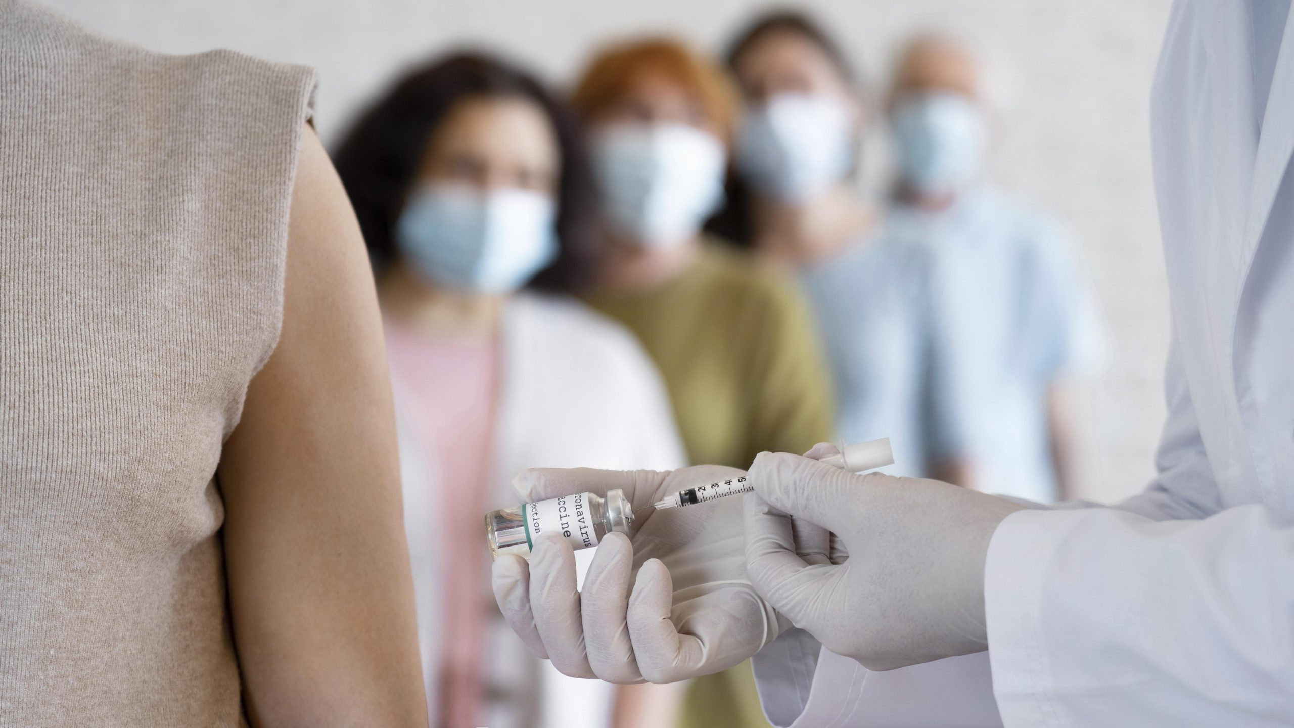 woman-getting-vaccine-shot-by-doctor
