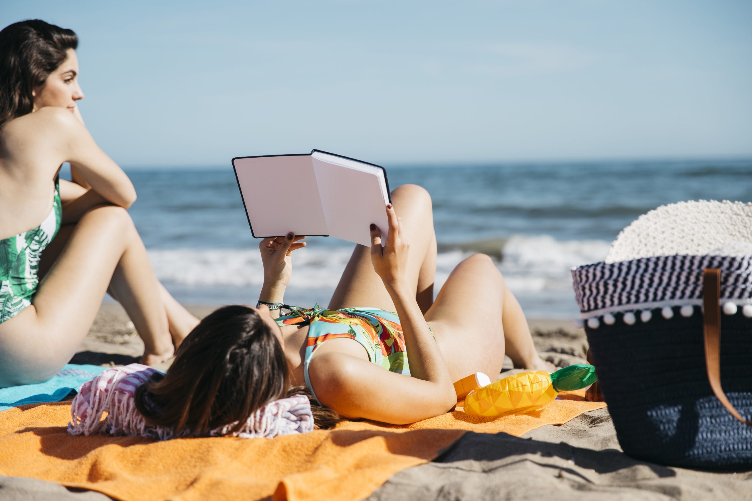 woman-reading-book-at-the-beach